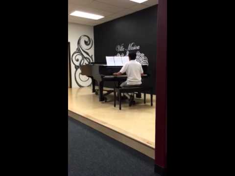 Jacob playing clocks by Coldplay at piano recital