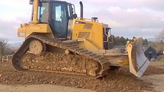 CAT D6 dozer at work pushing gravel for road construction