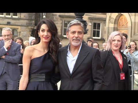 George Clooney doles out the compliments and pleasantries as he and his wife, attorney Amal Clooney, arrive at a charity gala in Edinburgh, where they're being honored for their humanitarian work. (March 14)