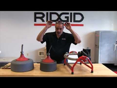 Installing the sink drum on the RIDGID K3800 drain cleaning machine