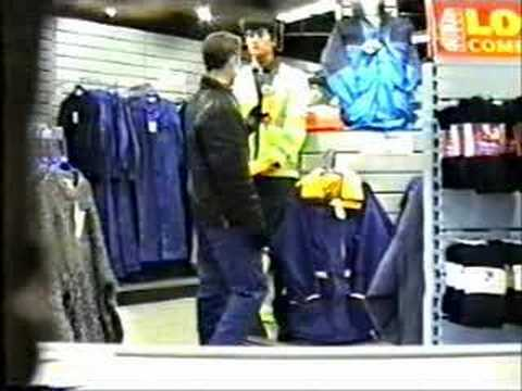 mannequin-man performming as a Living Mannequin: Prank on member of staff in safety clothing shop; he was told to check the mannequin in the shop. The mannequin was actually a living statue performer actor pretending to be a shop dummy, dressed in safety clothing and standing in a centre display in the shop. When the staff member comes past the mannequin actor moves suddenly to prank him but almost gets hit with karate chop. for Arco on 22/12/1994