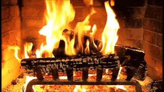 Old Traditional Christmas Carols music playlist with a Log Fire Fireplace
