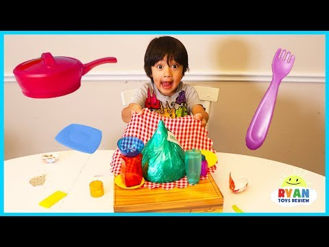 Ryan plays Crazy Cafe Board Game for kids with Egg Surprise Eggs