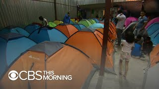 First group from migrant caravans reaches U.S.-Mexico border