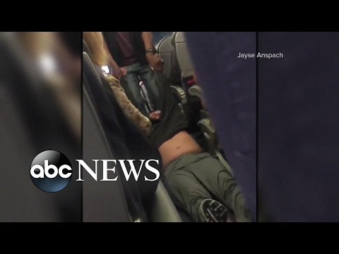 United Airlines passenger apparently dragged off flight after refusing to give up seat