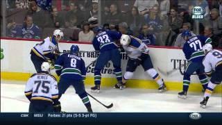 Ryan Reaves dots Zack Kassian's eye. St. Louis Blues vs Vancouver Canucks Mar 1 2015 NHL