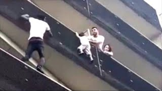 Malian hero scales Paris building to save child