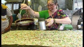 Amazing Hard Working Hyderabadi Lady Selling Rava Dosa / Pizza Dosa   Street Food Hyderabad