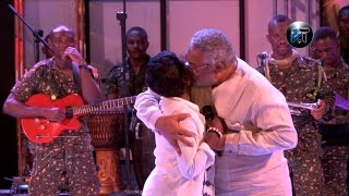 Jerry Rawlings gives Akosua Adjapong an electrifying peck