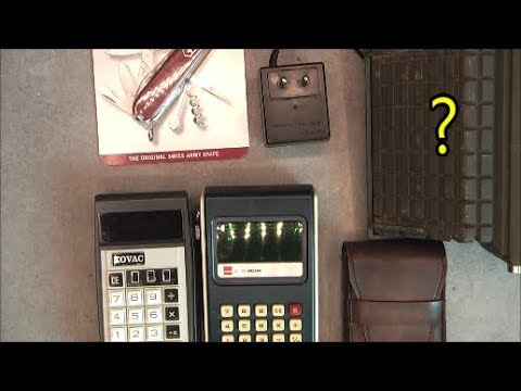Giant fleamarket finds: vintage calculators and tank NV periscope
