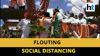 Karnataka Health Minister attends procession, no social distancing followed - Download this Video in MP3, M4A, WEBM, MP4, 3GP