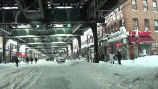 People Walking Along Roosevelt Avenue in Queens, New York  After Snow Storm