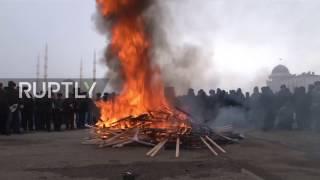 Russia: Ex-Islamic State fighters burn Baghdadi portraits in Grozny