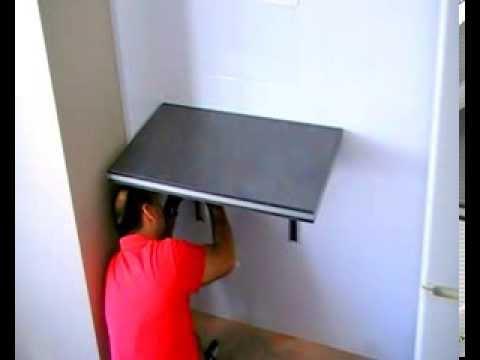 Como poner una mesa plegable en una pared.