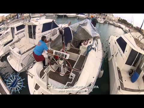 Enrollando la Genova usando la botavara