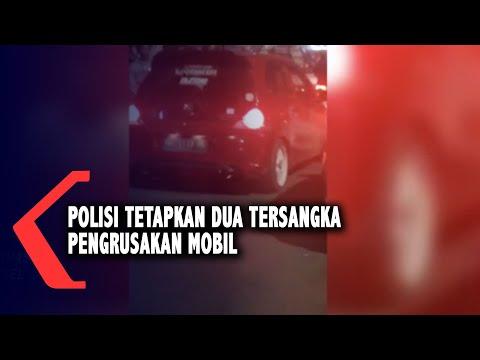 polisi tetapkan dua tersangka pengrusakan mobil