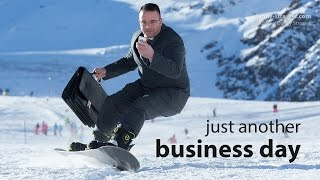 Snowboarding 133,2 kph in a business suit!