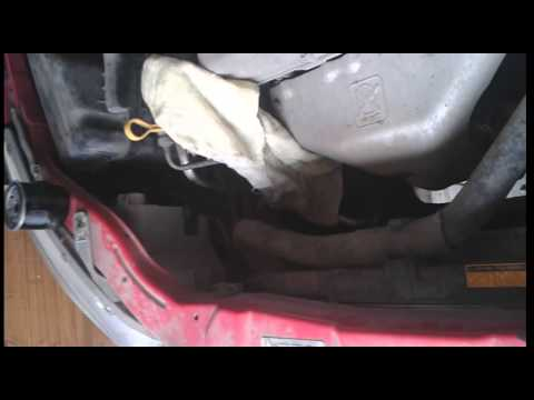 Фото к видео: Жужа-Шевроле Авео 1.2 84л.с (B12D1) замена масла в двигателе