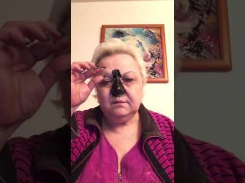 Die Maske für die Person mit der aktivierten Kohle gegen die Aale und