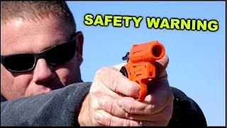 Live Shotgun Shell in flare pistol  - What happens?