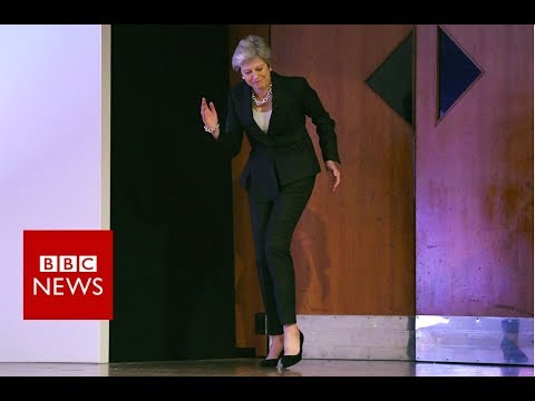 May's Dancing Queen arrival on conference stage - BBC News