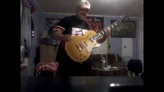 A cover of Judas Priest Rock Forever on a goldtop guitar by Epiphone