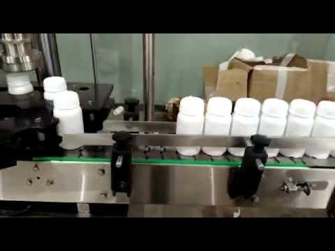 AUTOMATIC PESTICIDE BOTTLE LABELING MACHINE