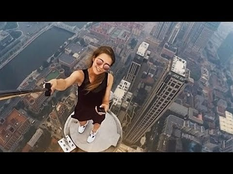 girl falls off building after taking a selfie..