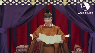 Japanese emperor takes the throne in Tokyo