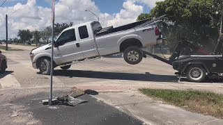 Man Tries to Drive Away in Truck as It's Being Towed