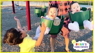 Twins first time on swing playground for kids and Baby