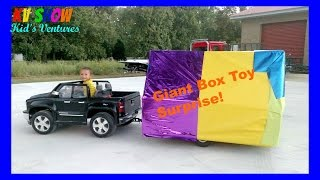 Hauling A Giant Box Toy Surprise Using His Power Wheels Ride On Chevy Truck And Custom Built Trailer