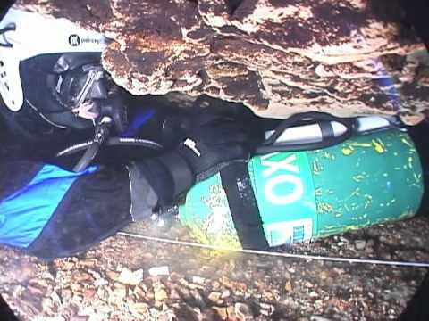 Video showing cave diving similar to the narrowest points of the Thai cave where rescuers must take their tanks off to fit through