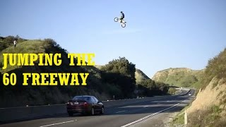 JUMPING THE FREEWAY IN TRAFFIC !!