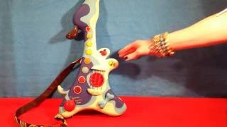 Woofer hound dog musical toy guitar by B toys
