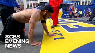Veteran crawls across Boston Marathon finish line in honor of fallen Marines