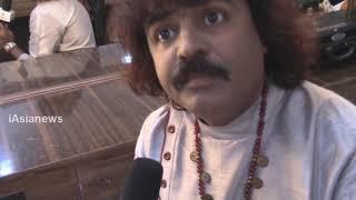 Pandit Pravin Godkhindi Flute Player speaking to iAsiaNews, Sri Mohan Hemmadi.