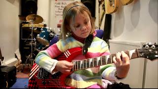 7 year old Mini Band guitarist Zoe Thomson plays Sweet Child O Mine by Guns' 'N Roses