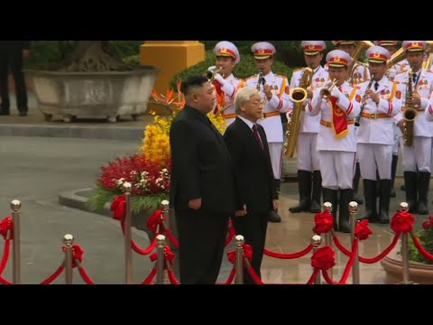 A day after his stunning summit breakdown with Donald Trump, North Korean leader Kim Jong Un smiled broadly as he strode down a red carpet with Vietnam's president, a military band playing as stiff-backed soldiers goose-stepped by. (March 1)