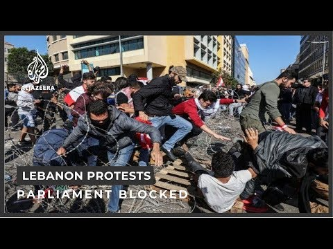 Protesters celebrate as Lebanon parliament session postponed