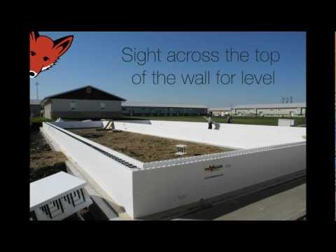 Building the 1st few rows of Fox Block insulated concrete forms.wmv