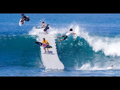 Surfers Launching From a Floating Dock