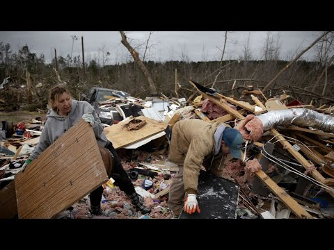 """One day after a devastating tornado tore through central Alabama, killing 23 people and injuring dozens more, Gov. Kay Ivey told residents, """"I've got your back."""" (March 4)"""