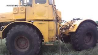 Заправка трактора К-700А в полевых условиях.