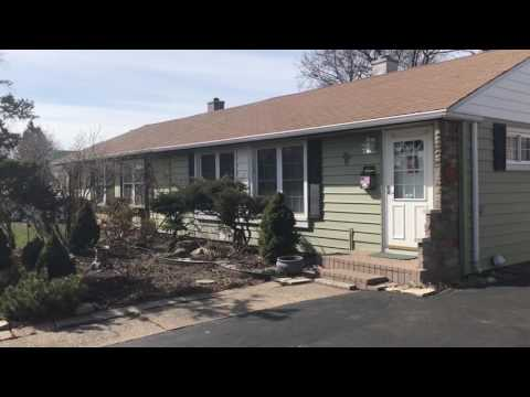 This homeowner chose to use insulated siding in her 1950's built home to help her heating and colling costs get reduced