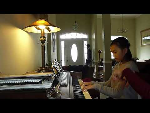 Helen Chau is playing Romanza by Angela Marshall.  Judy has instructed Helen what to work on, and then she plays it again with improvements.