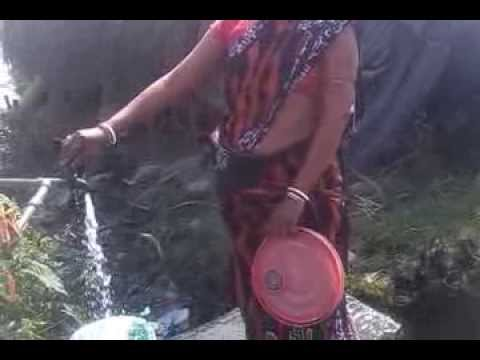 CHAMPA BOUDI POURING THE WATER IN A BUCKET..!!!