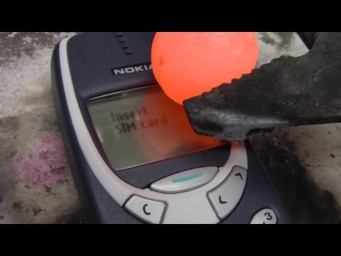Tough As Nails Nokia Cell Phone Fights Valiantly Against Red Hot Nickel Ball