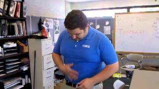 August 11 2010. Mike Lovely shirt is too tight. Balise Ford of Wilbraham.