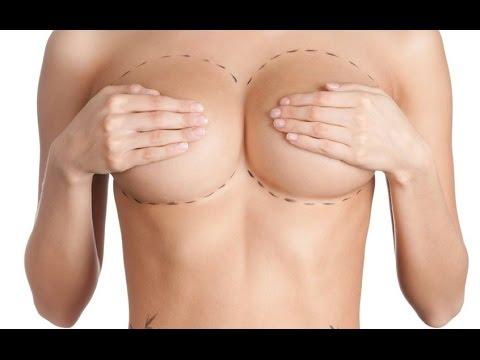 Die Erhöhung der Brust die Spritze